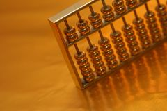 Golden abacus Stock Images