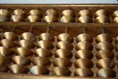 Golden abacus. Royalty Free Stock Photo