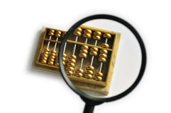 Golden abacus magnified. A golden abacus with part of it magnified, showing number 328 -- close to pronouciation of prosperous business in Cantonese Stock Photography