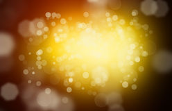 Golden abstract background with bokeh effect Royalty Free Stock Photo