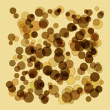 Golden abstract background in the form of a spray of scales and spots. Royalty Free Stock Image