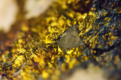 Golden Abstract background from natural mineral. Macro Royalty Free Stock Photo