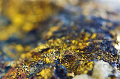 Golden Abstract background from natural mineral. Macro Stock Image