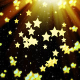Golden, abstract background with stars and bokeh Royalty Free Stock Photography