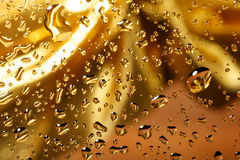 Golden abstract background with water drops Royalty Free Stock Images