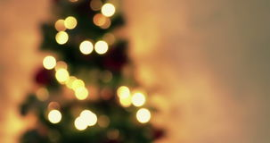 Golden abstract blinking blurred Christmas tree lights bokeh on gold warm background, festive holiday stock video