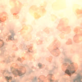 Golden abstract blurred heart symbols Stock Images