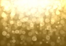 Golden abstract bokeh background. Gold Christmas abstract bokeh glitter lights festive background. Golden yellow beige orange circle bokeh texture Stock Photos