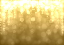 Golden abstract bokeh background. Gold Christmas abstract bokeh glitter lights festive background. Golden yellow beige orange circle bokeh texture. Space for Royalty Free Stock Image