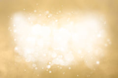 Golden Abstract festive background. Holiday Glitter Defocused Stock Photography