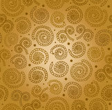 Golden abstract spiral pattern. Seamless decorative background Royalty Free Stock Images