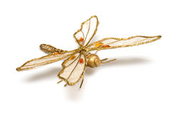 Golden accessory in form dragonfly Stock Photos