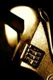 Golden adjustable spanner Stock Image