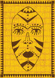 Golden african mask. Stylized african tribal mask on golden grunge background Stock Photo