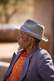 Golden age. Portrait of elderly  african man with a broken had and old suit Stock Photography