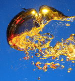 Golden air bubbles in water Royalty Free Stock Photography