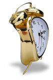 Golden alarm clock Stock Image