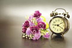 Golden alarm clock. With flower Stock Images