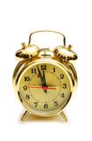 Golden alarm clock isolated. On the white Royalty Free Stock Image