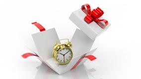 Golden alarm clock in open gift box Royalty Free Stock Photo