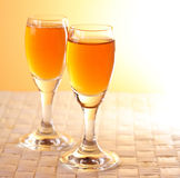 Golden alcohol glasses. Two glasses of golden alcohol royalty free stock photo