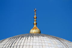 Golden alem on top of the mosque domes in Istanbul Stock Photography
