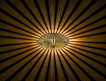 Golden all-seeing anonymous eye with lines and lights abstract religion background. Golden all-seeing anonymous eye with lines and lights abstract religion royalty free stock photography