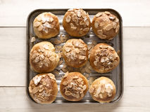Golden almond buns Stock Photo