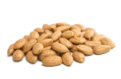 Golden almonds isolated. On white background royalty free stock photo