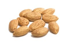 Golden almonds isolated. On white background stock photography