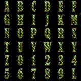 Golden alphabet on black background royalty free stock images