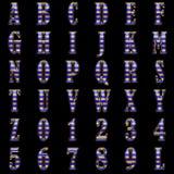 Golden alphabet on black background Stock Photography