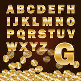 Golden alphabet and coin Royalty Free Stock Photo