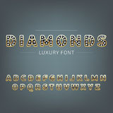 Golden alphabet with diamonds. Luxury, royal, wealth, glamour symbol Royalty Free Stock Photo