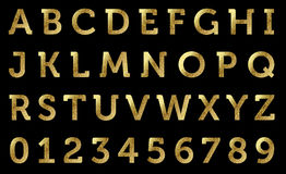 Golden alphabet. Glitter and golden alphabet and numbers Stock Photography