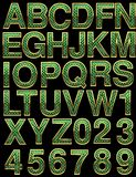 Golden alphabet with green Royalty Free Stock Photography