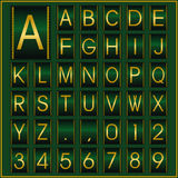 Golden alphabet in green frame Royalty Free Stock Photo