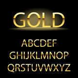 Golden alphabet letters. Golden font type Royalty Free Stock Photo