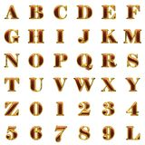 Golden alphabet with red wood Royalty Free Stock Photography