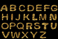 Golden alphabet set. Gold letters unusual textured Stock Photos
