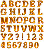 Golden alphabet with signs, marks and numbers Stock Images
