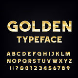 Golden Alphabet Vector Font. Metallic effect shiny letters and numbers on a dark background. Stock Image