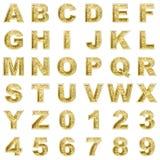 Golden alphabet on white background Royalty Free Stock Images