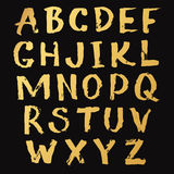 Golden Alphabet A-Z hand written with a brush Royalty Free Stock Photography