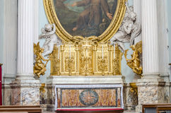 Golden altar with candles with Jesus Christ and the holy apostles in Basilica di San Giovanni in Laterano in Rome, capital of Ital Stock Photography