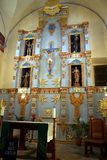 Golden Altar. Renovated church altar with blue paint and gold trim Royalty Free Stock Photography