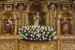 Golden Altar. With sculptures of saints Stock Photo