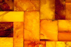 Golden amber mosaic as background or texture. Gem. Stock Images