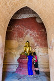 Golden ancient Buddha statue at Htilo Minlo Pagoda. Stock Images