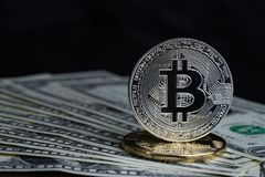Golden And Silver Bitcoin Crypto Currency Coin On US Dollar Bank Stock Photo
